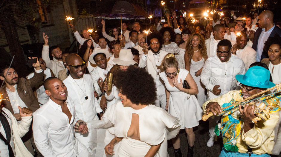 NEW ORLEANS, LA - NOVEMBER 16:  Musician Solange Knowles (C) and her new husband, music video director Alan Ferguson second line in the streets of New Orleans with family and guests after her wedding on November 16, 2014 in New Orleans, Louisiana.  (Photo by Josh Brasted/WireImage)