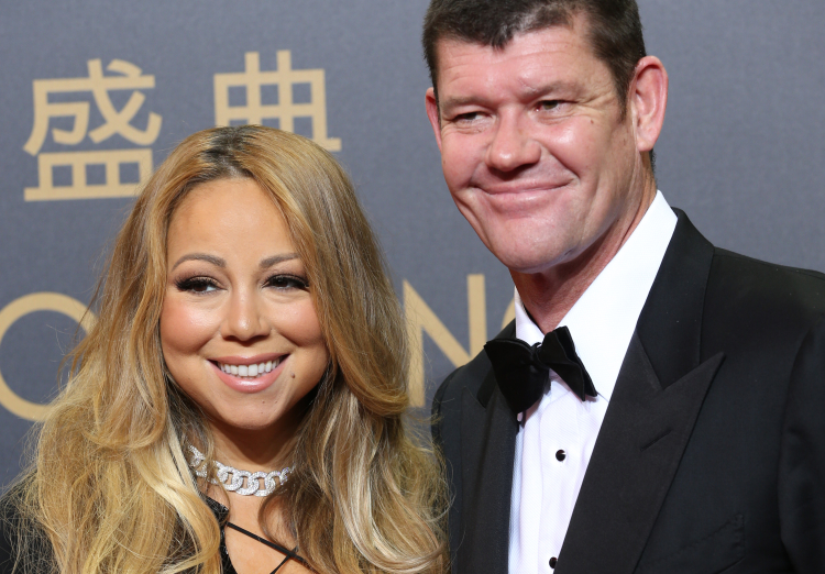 Melco Crown Entertainment's Co-chairman, James Packer, right, and singer Mariah Carey pose on the red carpet of the opening ceremony for the Studio City project in Macau, Tuesday, Oct. 27, 2015. China's world-beating gambling hub is getting a taste of Hollywood glamour as its newest casino resort makes its debut on Tuesday with a glitzy grand opening that masks turmoil behind the scenes. (AP Photo/Kin Cheung)