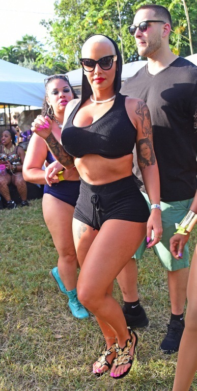 **PREMIUM EXCLUSIVE RATES APPLY**Booty-ful Amber Rose parties in skimpy outfit at the Trinidad Carnival. The hip hop celebrity is taking part in the world famous party alongside Blac Chyna, on the back of a Twitter storm with Kanye West.