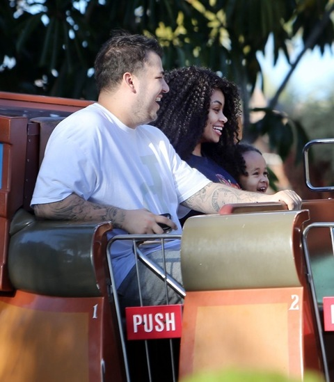 **PREMIUM RATES APPLY** Rob Kardashian enjoys a day at Legoland with girlfriend Blac Chyna and rides a slide with her son King Cairo in LA