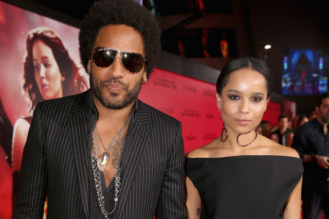 "LOS ANGELES, CA - NOVEMBER 18:  Actor/musician Lenny Kravitz (L) and daughter Zoe Kravitz attend premiere of Lionsgate's ""The Hunger Games: Catching Fire"" - Red Carpet at Nokia Theatre L.A. Live on November 18, 2013 in Los Angeles, California.  (Photo by Christopher Polk/Getty Images)"