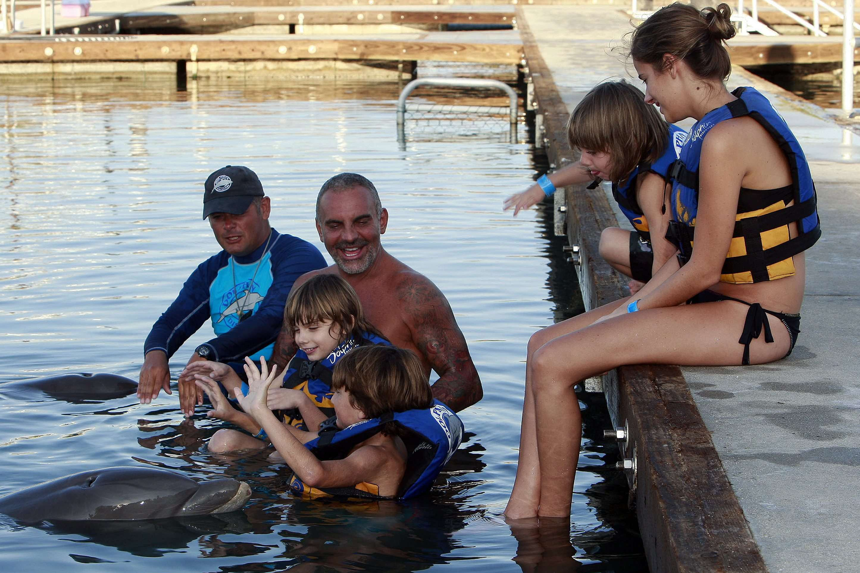 Fashion designer Christian Audigier and Nathalie Sorensen celebrate Thanksgiving with his children, Dylan, Rocco and Vito, on a trip to see dolphins in the new marina of Puerto Los Cabos. Cabo San Lucas, Mexico - 24.11.11 Credit: (Mandatory): BAC/WENN.com/audigier_dolphin_251111.Christian_Audigier_14_/1111252310