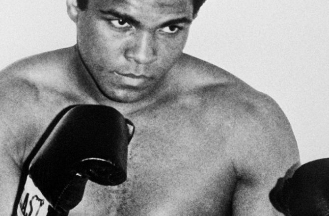 """(FILES) This file photo taken on January 01, 1965 U.S. boxing champion Cassius Clay alia Muhammad Ali in Paris. Boxing icon Muhammad Ali died on Friday, June 3, a family spokesman said in a statement. """"After a 32-year battle with Parkinson's disease, Muhammad Ali has passed away at the age of 74,"""" spokesman Bob Gunnell said. / AFP PHOTO / PIGISTE"""